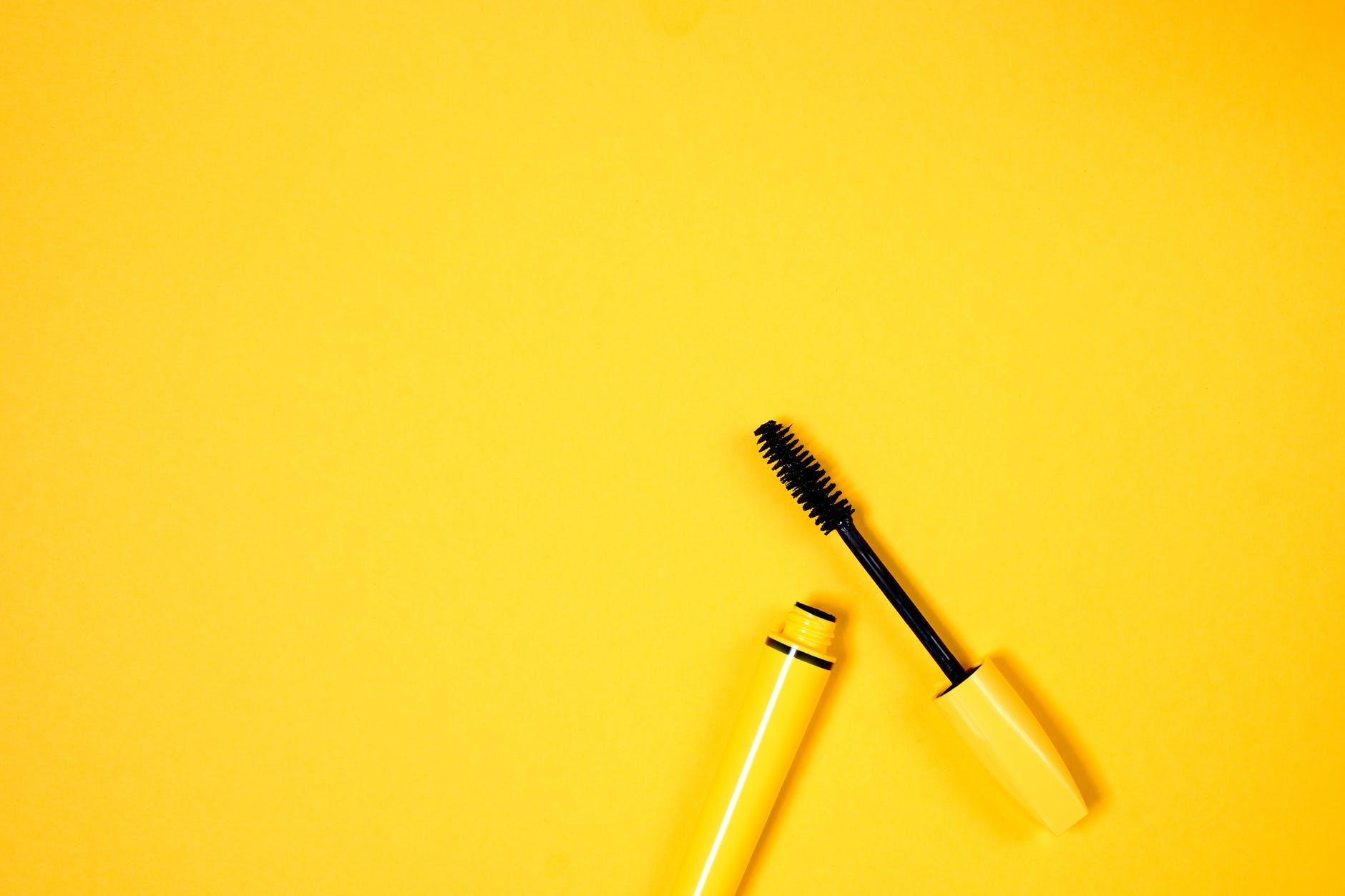yellow mascara on yellow background